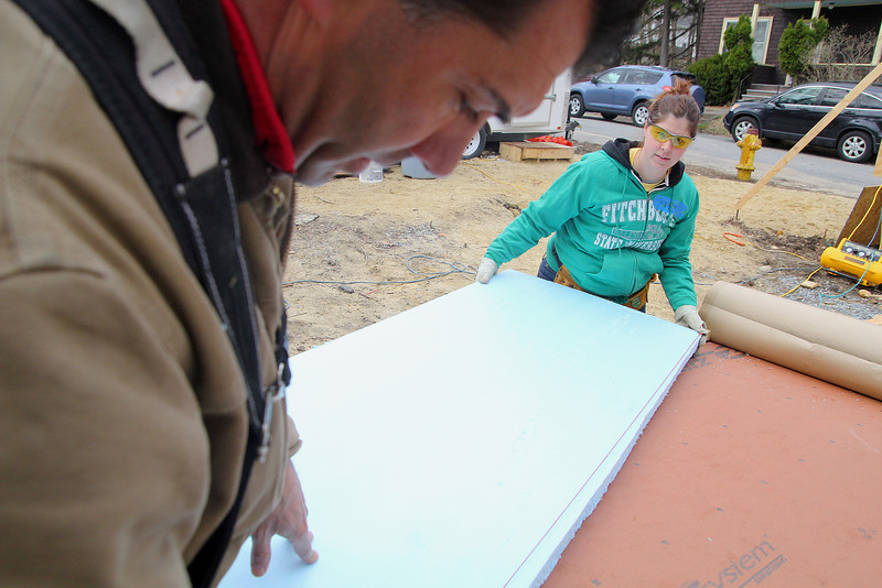 Kristy Collins a Fitchburg State University employee helps the project manager Vincent Benincasa with the Habitat for Humanity in Fitchburg on Friday morning. SENTINEL & ENTERPRISE/JOHN LOVE