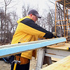 Stefan Dodd a employee with Fitchburg State University works on the Habitat for Humanity house in Fitchburg on Oakland Street which is still under construction and should be done this summer. SENTINEL & ENTERPRISE/JOHN LOVE
