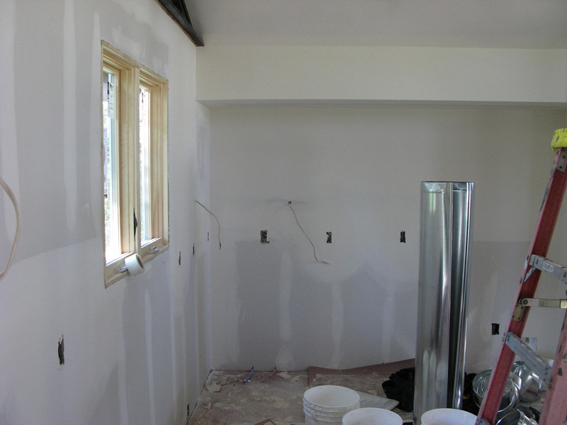 A view of the new kitchen wall--the beam is now concealed behind drywall.