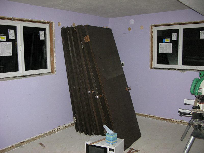 Office gets its new windows--and little plugs in the wall where the insulation was blown in.