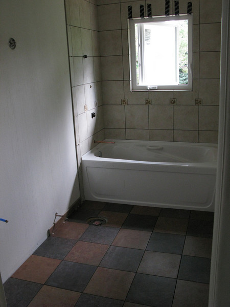 Some of the bathroom tile in, also sans grout.