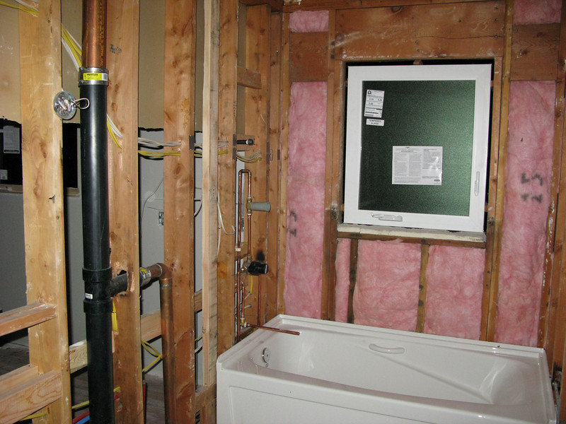 The bathroom--now with insulation and plumbing, but still a ways to go!