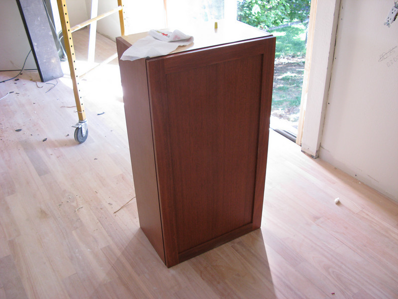 A lone cabinet waiting its turn to be installed.