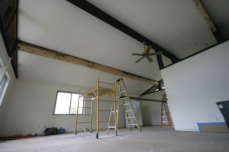 In the process of stripping the beams.