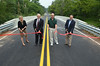 Officials, from left, Lynn Bush, Bucks County Planning Commission,  State Representative Paul Clymer, Dave Nyman, Chairman,  East Rockhill Township Board of Supervisors, and Jim Nietupski, East Rockhill Township Supervisor, cut the  ribbon for the new North Rockhill Road bridge in East Rockhill Township.   Friday, August 1, 2014.   Photo by Geoff Patton
