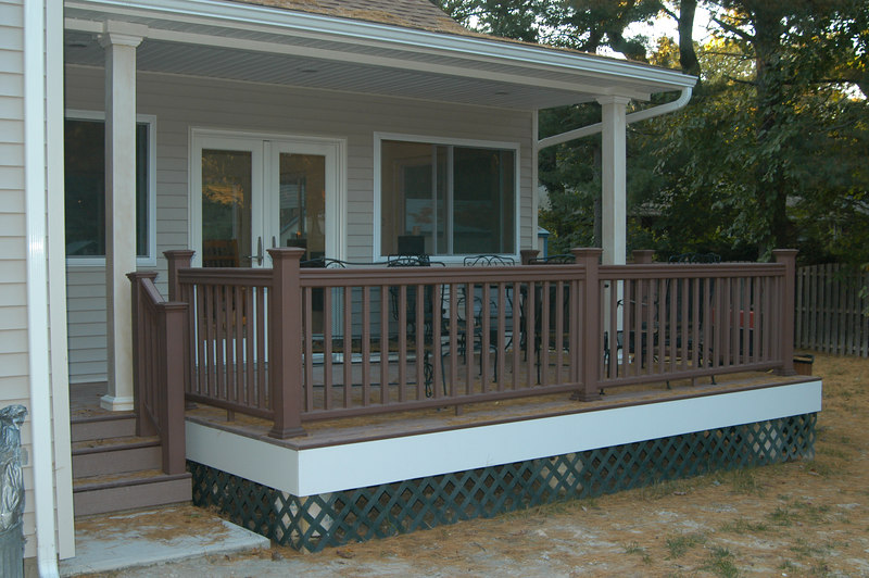 Deck on back of house, french doors open into new room.  Decking & rails are Timbertek (synthetic wood).
