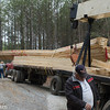 These trusses were dumped at the head of a 1/4-mile gravel drive. The delivery driver swore up and down that he drove to the end of the drive and it was so muddy he couldn't drop the trusses and get out. Strangely, there were no truck tracks at the house end of the driveway..... We had hired a crane to set trusses, we had to use him to load them on a large flatbed truck(hired from the same company) to get them close enough to the house to set. The builder backcharged the truss company for the additional equipment and time, including my crew's.