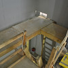 A view from the second floor through what will be the building's staircase.