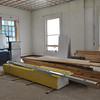 Shaftliner and 2x12 boards to be installed on the second floor of Language Hall.  The sample window for the building can be seen on the left.