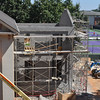 The block walls of the Language Hall addition are complete, and framing has begun.