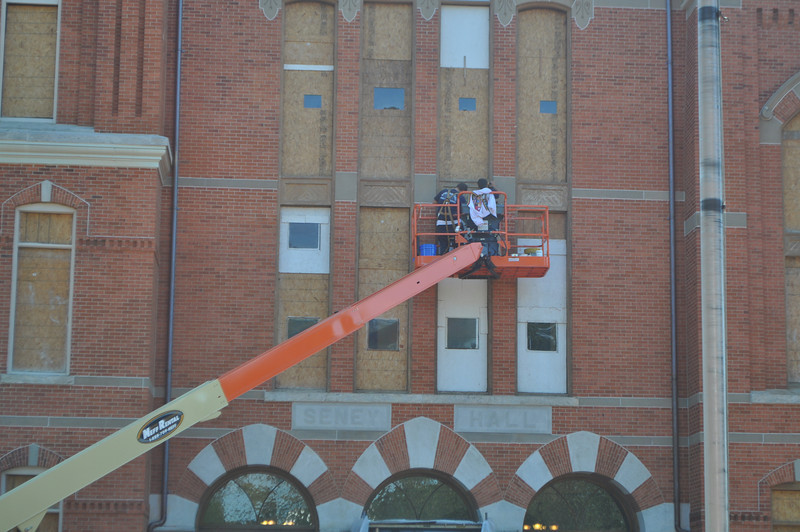 Work crews repair the frames of the north-elevation windows in Seney Hall in preparation for painting and eventual re-installation of the new windows.