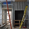 Framing near the first-floor elevator entrance, with drywall visible as well.