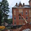 Work crews re-install windows on the east side of Seney Hall.