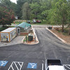 Behind Humanities Hall paving is complete, and the curb cut to Haygood Avenue has been made.