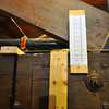 A ruler atop a truss in Williams Hall/Old Gym shows dramatic proof of the need for current work.  This truss was 8 inches off horizontal plumb.