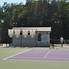 View of the supply hut on the tennis courts, looking west.