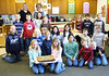 Kristen Hansen (left) delivering a yummy Lynden Dutch Bakery maple bar cake to local students who participated in the Lynden Tribune's Design an Ad contest. These students worked very hard designing and coloring advertisments for HBHansen.  Thank you students!