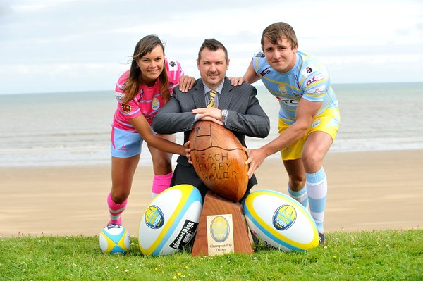 SWANSEA / Dave<br /> Tuesday 14th June 2016<br /> Swansea Bay Beach Rugby Launch with from left, referee Bianca Zietsman, event sponsor Neil Evans and player Rhodri Williams.