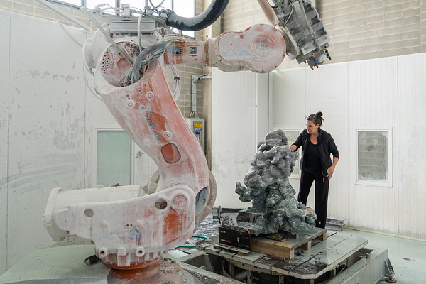 Robot carving marble to make sculpture from data driven form