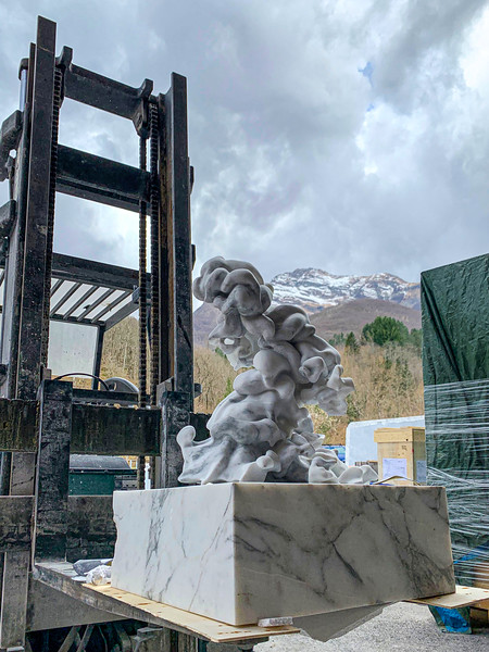 Artwork of cloud in marble on forklift during carving