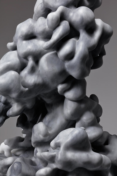 The dark gray marble of this sculpture make visual the fluid nature of clouds