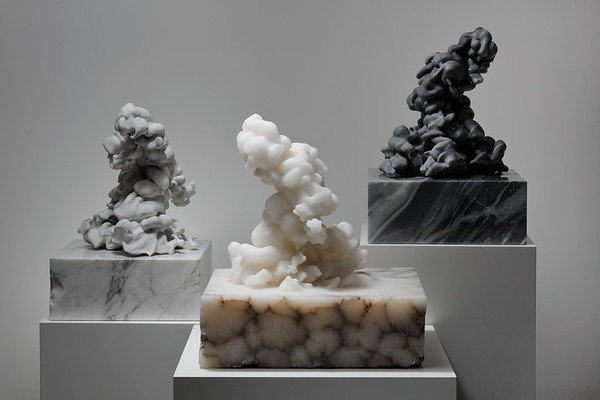 Installation of three cloud sculptures in white marble, gray marble and alabaster