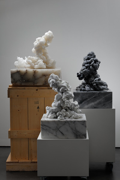 Grouping of three cloud sculptures in marble and alabaster