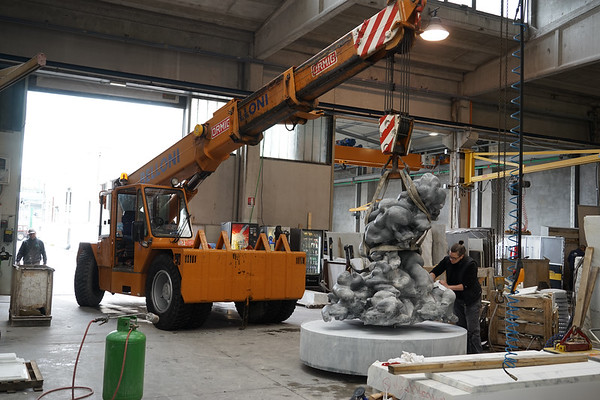 Karen LaMonte working on the monumental sculpture of a cloud in marble.