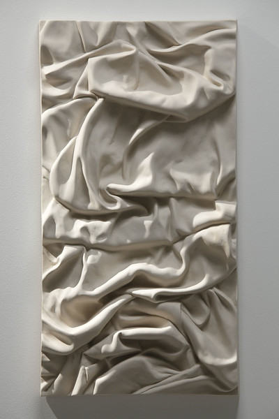"Ceramic sculpture of drapery called Ink in Water/Smoke 2009, 25"" x 13"" x 3"""