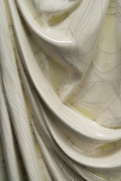 Detail of contemporary drapery sculpture in ceramic with crackle glaze