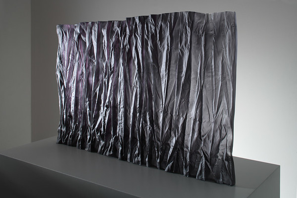 Sculpture of abstract drapery in cast glass