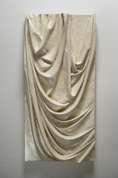 Sculpture of drapery in ceramic with crackle glaze 