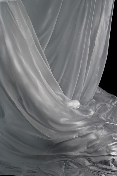 Detail of drapery on seated female figure in sculpture by Karen LaMonte