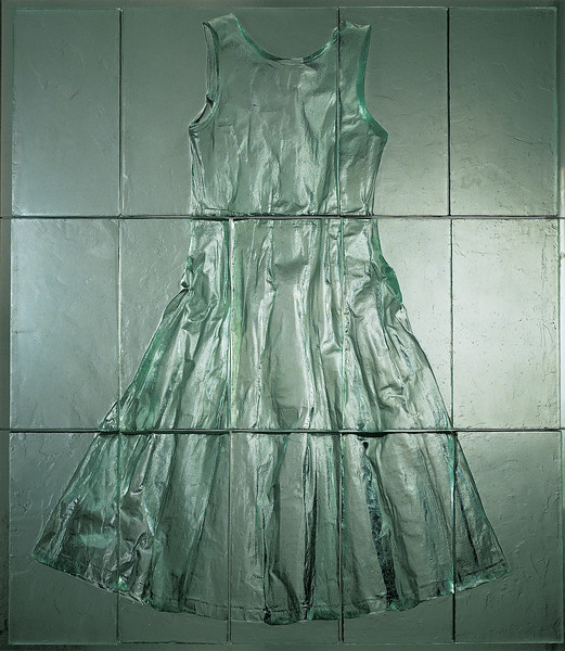 A unique artwork of an dress cut into tiles in bas-relief cast glass by Karen LaMonte