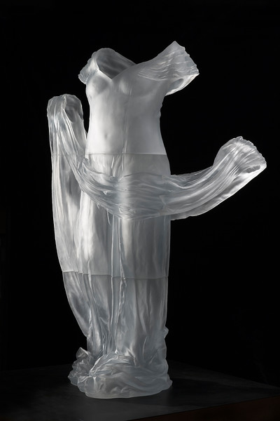 Dress Impression with Drapery is a life-size sculpture of a dress with the impression of an absent body visible through cast glass