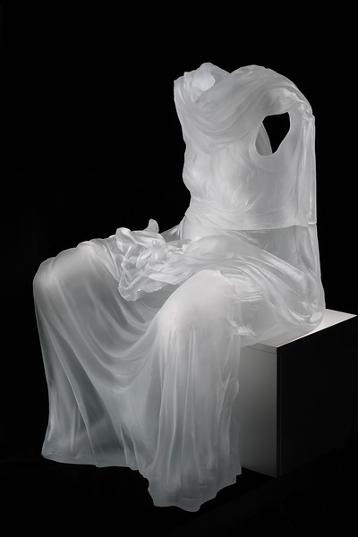 Sculpture of seated female form without a body looks at perception and culture