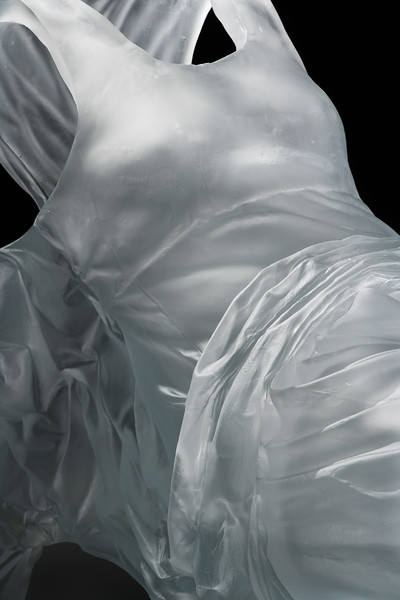 Detail of contemporary sculpture of dress with baroque drapery investigates the perception of the female figure throughout time