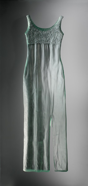 Contemporary sculpture of dress in bas-relief cast glass