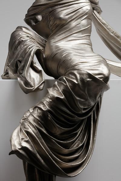 Seated figure contemporary art sculpture in white bronze by artist Karen LaMonte. ⅓ scale