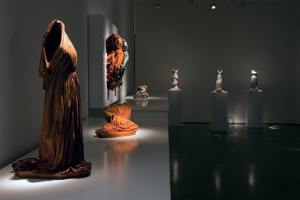 Installation of dress sculptures and wrapped female forms are an exploration of the meaning of body, culture and fashion