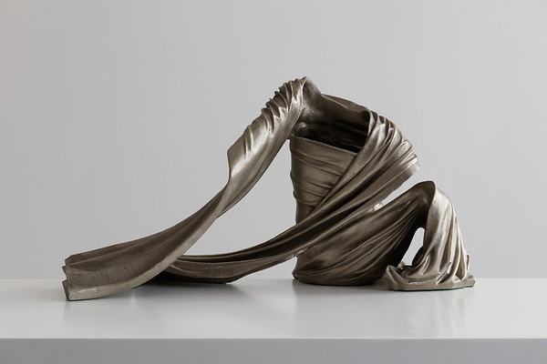 Drapery on a sculpture of a seated figure by contemporary artist Karen LaMonte.  White bronze, ⅓ scale