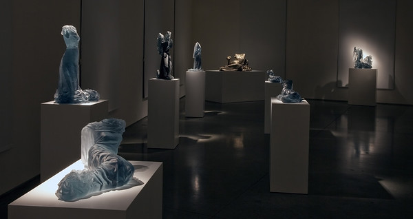 Installation of bronze and glass dress sculptures and wrapped female forms are an exploration of the meaning of body, culture and fashion