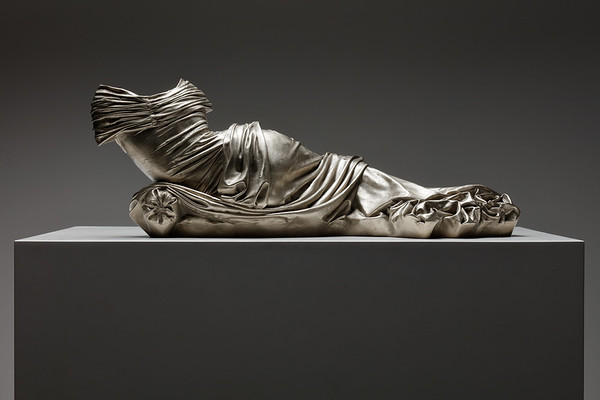 Sculpture of reclining female figure which challenges the male gaze by Karen LaMonte. ⅓ life-size.