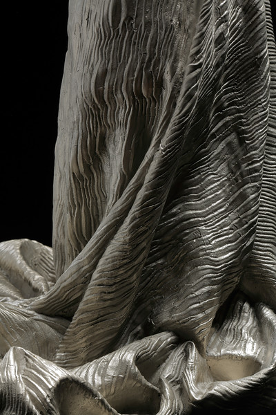 Detail of drapery on female artist Karen LaMonte's dress sculpture in white bronze