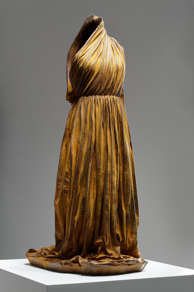 Female artist Karen LaMonte's rusted iron dress sculpture, ⅓ life-size