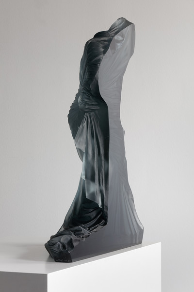 Contemporary sculpture of a female figure wrapped in drapery brings together ancient art, fashion, and couture