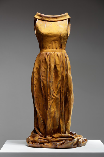 Figurative sculpture of a dress in rusted iron. ⅓ life-size.