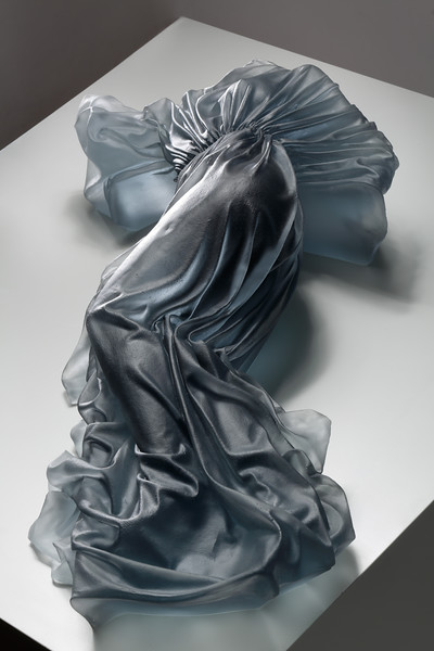 Wrapped reclining female form in sculpture by contemporary artist Karen LaMonte, cast glass, ⅓ scale