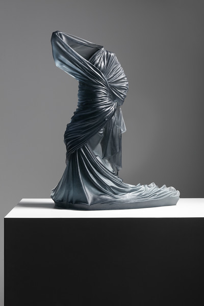 Contemporary sculpture of a female figure wrapped in drapery brings together ancient art, fashion, and couture to make a modern critique