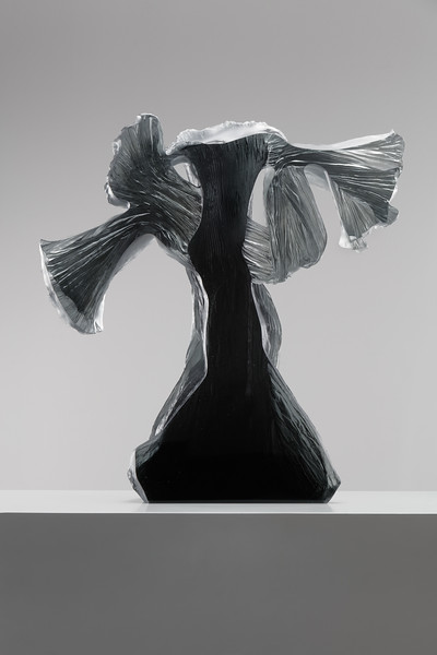 Polished glass allows a view into the contemporary sculpture of a female figure by Karen LaMonte